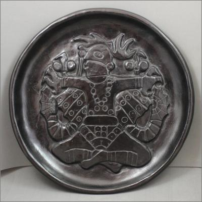 Deep Carved Plate with Birdman design